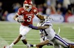 Arkansas wide receiver Joe Adams (3) is pushed out of bounds by Kansas State defensive back David Garrett (27) and defensive back Emmanuel Lamur (23) during the second half of the Cotton Bowl NCAA college football game, Friday Jan. 6, 2012 in Arlington, Texas. Arkansas won 29-16. (AP Photo/Matt Strasen)
