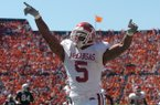 Arkansas running back Darren McFadden celebrates after scoring a 63-yard touchdown during a game against Auburn on Saturday, Oct. 7, 2006, in Auburn, Ala. The Razorbacks beat the No. 2 Tigers 27-10.