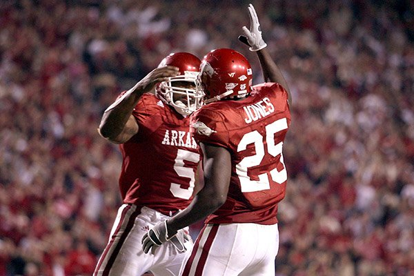 Arkansas running backs Darren McFadden (5) and Felix Jones (25) celebrate during a game against South Carolina on Saturday, Nov. 3, 2007, in Fayetteville.