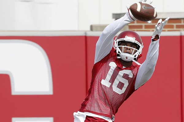 Arkansas receiver La'Michael Pettway catches a pass during practice Thursday, July 27, 2017, in Fayetteville.