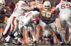 Arkansas quarterback Clint Stoerner fumbles the ball during the fourth quarter of a game against Tennessee on Saturday, Nov. 14, 1998, in Knoxville, Tenn. The No. 1 Volunteers scored four plays later to beat the No. 10 Razorbacks 28-24.