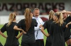 Arkansas soccer coach Colby Hale speaks Wednesday, Aug. 16, 2017, to members of his team at Razorback Field in Fayetteville.