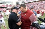 TCU coach Gary Patterson, left, shakes hands with Arkansas coach Bret Bielema after an NCAA college football game in Fayetteville, Ark., Saturday, Sept. 9 2017. (AP Photo/Michael Woods)