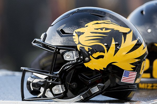 A Missouri football helmet sits on the bench during the fourth quarter of an NCAA college football game against Purdue Saturday, Sept. 16, 2017, in Columbia, Mo. (AP Photo/L.G. Patterson)