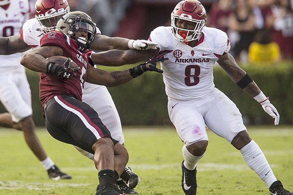 Arkansas linebacker De'Jon Harris (8) makes a tackle during a game against South Carolina on Saturday, Oct. 7, 2017, in Columbia, S.C.
