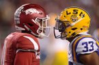 Arkansas cornerback Ryan Pulley, left, and LSU fullback Trey Gallman exchange words during the second quarter of a game Saturday, Nov. 12, 2016, in Fayetteville. LSU won 38-10.