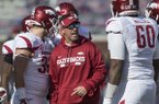 Arkansas offensive coordinator Dan Enos talks to players prior to a game against Ole Miss on Saturday, Oct. 28, 2017, in Oxford, Miss.