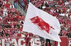 Arkansas cheerleader carries a flag around the stadium during a game against Coastal Carolina on Saturday, Nov. 4, 2017, in Fayetteville.