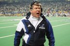 Dallas Cowboys head coach Jimmy Johnson yells from the sidelines during the fourth quarter at the Super Bowl against the Buffalo Bills, Sunday, Jan. 30, 1994 at the Georgia Dome in Atlanta. Johnson's Cowboys defeated the Buffalo Bills 30-13 to win their second consecutive Super Bowl title. (AP Photo/Ron Heflin)