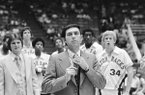 University of Arkansas head basketball coach Eddie Sutton watches as his Razorbacks are introduced prior to their Southwest Conference Tournament game with SMU in Houston, Texas, March 2, 1978. (AP Photo)