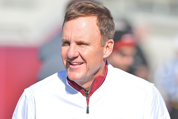 Arkansas coach Chad Morris watches warmups prior to the Class 4A State Championship Game between Warren and Arkadelphia on Saturday, Dec. 9, 2017, at War Memorial Stadium in Little Rock.