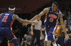 Auburn forward Horace Spencer (0) is congratulated by guard Bryce Brown (2) after dunking the ball against Tennessee in the first half of an NCAA college basketball game Tuesday, Jan. 2, 2018, in Knoxville, Tenn. (AP Photo/Crystal LoGiudice)