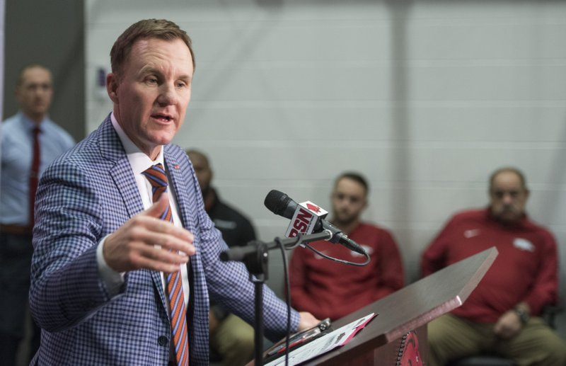 Arkansas coach Chad Morris speaks Wednesday, Jan. 10, 2018, during a press conference to introduce new assistant coaches at the Fred W. Smith Football Center in Fayetteville.