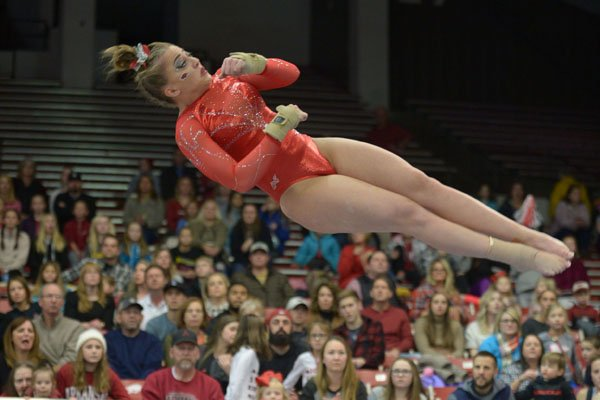Arkansas' Sydney McGlone competes Friday, Jan. 12, 2018, in the vault portion of the 11th-ranked Razorbacks' meet with sixth-ranked Kentucky in Barnhill Arena in Fayetteville.