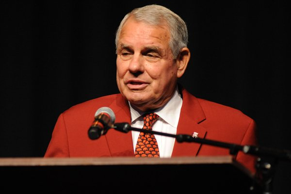 Ken Hatfield, former player and Arkansas football caoch, speaks Saturday, Aug. 19, 2017, during a celebration in Bud Walton Arena on the University of Arkansas campus in Fayetteville for the life of Frank Broyles, the former coach and athletics director.