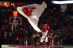 Arkansas mascot Big Red waves a flag prior to a game against Vanderbilt on Saturday, Feb. 10, 2018, in Fayetteville.