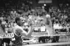 Arkansas' Sidney Moncrief gets ready to welcome one of his teammates during introductions Saturday, Feb. 11, 1978, in Fort Worth, Texas, before the Razorbacks pulled off another victory, beating TCU 77-57. (AP Photo)