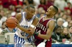 Anthony Epps (25) of Kentucky, left, battles Corey Beck (14) of Arkansas in the first half of the SEC Tournament championship game at the Georgia Dome in Atlanta, March 12, 1995. (AP Photo/Andrew Innerarity)