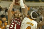 Arkansas' Steven Hill makes a shot over Tennessee's Wayne Chism with 5.3 seconds remaining to give the Razorbacks a 92-91 win over the Volunteers in the SEC Tournament semifinals on Saturday, March 15, 2008, in Atlanta.