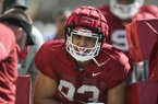 Arkansas defensive lineman Isaiah Nichols goes through drills Saturday, March 3, 2018, in Fayetteville. Nichols, a freshman, is going through spring practice after graduating a semester early from Springdale High School.