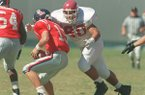 Arkansas nose guard Junior Soli sacks Ole Miss quarterback Josh Nelson during a game Saturday, Oct. 4, 1995, in Memphis, Tenn.