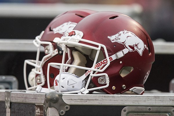 Arkansas football helmets sit atop storage bins during a game against Mississippi State on Saturday, Nov. 18, 2017, in Fayetteville.