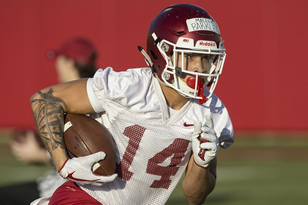 Maleek Barkley runs a drill Thursday, March 1, 2018, during Arkansas spring football practice at the Fred W. Smith Football Center in Fayetteville.