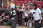 Hannah McEwen rounds third and high fives Arkansas coach Courtney Deifel following a home run in the Razorbacks' game against Wichita State Sunday May 20, 2018 during the NCAA Regional Softball Tournament at Bogle Park in Fayetteville. Arkansas won 6-4 and advanced to its first super regional.