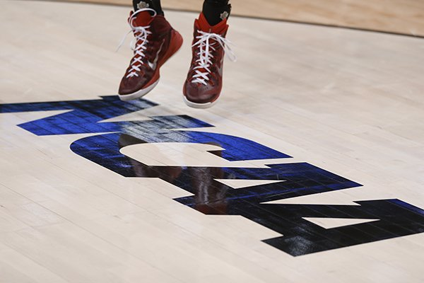 A Lafayette basketball player shoots a jump shot on the NCAA floor logo during practice for an NCAA college basketball second round game in Pittsburgh Wednesday, March 18, 2015. (AP Photo/Keith Srakocic)