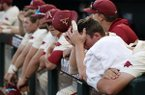 Arkansas players react after the final out of the College World Series championship game against Oregon State on Thursday, June 28, 2018, in Omaha, Neb. The Razorbacks lost 5-0.