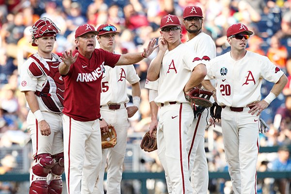 Arkansas coach Dave Van Horn motions toward an umpire before making a pitching change during the College World Series championship game Thursday, June 28, 2018, in Omaha, Neb.