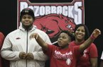 Arkansas Democrat-Gazette/STATON BREIDENTHAL --12/20/17--Fordyce's Billy Ferrell (left) along with his mother Rene Stuckey (right) and his younger brother Malik Harden, 12, call the Hogs Wednesday afternoon after Ferrell signed to play football at the University of Arkansas.
