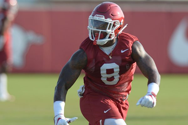 Arkansas linebacker De'Jon Harris participates in a drill Friday, Aug. 3, 2018, during practice at the university practice field on campus in Fayetteville.