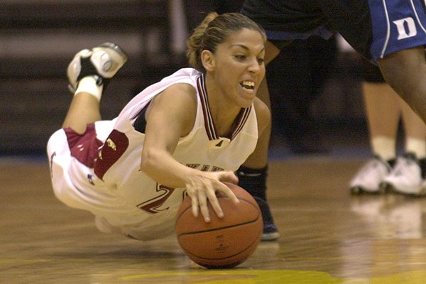Arkansas' India Lewis falls to the court trying to catch a loose ball during the championship game against Duke at the Paradise Jam Basketball Tournament in St. Thomas, Virgin Islands, Saturday, Nov. 30, 2002. Duke beat Arkansas 74-72 in overtime. (AP Photo/Andres Leighton)