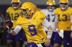LSU quarterback Joe Burrow (9) runs through drills during their NCAA college football practice in Baton Rouge, La., Monday, Aug. 6, 2018. (AP Photo/Gerald Herbert)