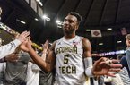 Georgia Tech guard Josh Okogie (5) celebrates with fans after defeating North Carolina State in an NCAA college basketball game, in Atlanta, Thursday, March 1, 2018. (AP Photo/Danny Karnik)