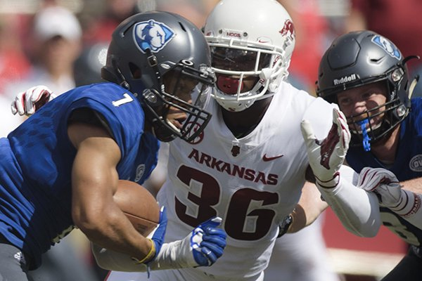 Arkansas defensive back D'Vone McClure (36) pursues Eastern Illinois receiver Aaron Gooch (7) during a game Saturday, Sept. 1, 2018, in Fayetteville.