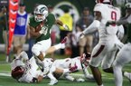 Colorado State running back Izzy Matthews breaks away from Arkansas defenders in the second half of an NCAA college football game Saturday, Sept. 8, 2018, in Fort Collins, Colo. Colorado State won 34-27. (Austin Humphreys/The Coloradoan via AP)