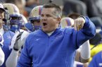 Tulsa coach Todd Graham gestures on the sideline as his team plays Notre Dame during the first half of an NCAA college football game, Saturday, Oct. 30, 2010, in South Bend, Ind., when Tulsa defeated Notre Dame 28-27. Graham hired Gus Malzahn and Chad Morris at Tulsa. (AP Photo/Michael Conroy)