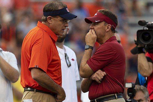 Auburn head coach Gus Malzahn chats with Arkansas head coach Chad Morris as their teams warm up before an NCAA college football game, Saturday, Sept. 22, 2018, in Auburn, Ala. (AP Photo/Vasha Hunt)