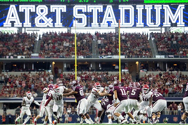 Texas A&M quarterback Kellen Mond (11) drops back to pass against Arkansas during the fourth quarter of an NCAA college football game Saturday, Sept. 29, 2018, in Arlington, Texas. (AP Photo/Jeffrey McWhorter)