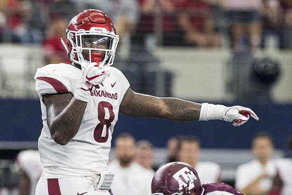 Arkansas linebacker De'Jon Harris calls out a play at the line of scrimmage during a game against Texas A&M on Saturday, Sept. 29, 2018, in Arlington, Texas.