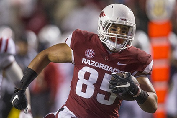 Cheyenne O'Grady, Arkansas tight end, runs in a touchdown on a 39 yard catch in the 1st quarter vs Ole Miss Saturday, Oct. 13, 2018, at War Memorial Stadium in Little Rock.