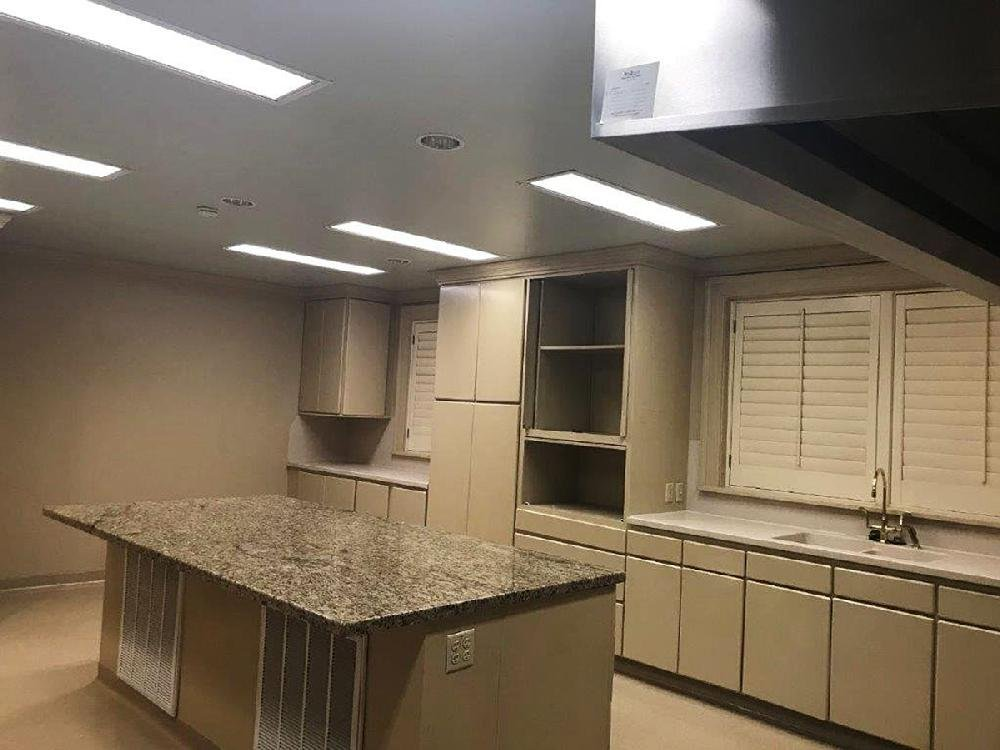 The kitchen at the Governor's Mansion is shown before renovations (shown) and after. Slippery flooring was replaced with a shiny epoxy finish, and a new range, countertops, cabinets and an additional dishwasher were put in.