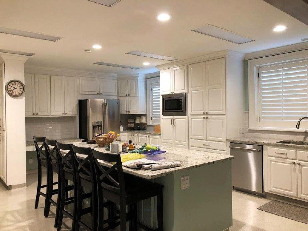 The kitchen at the Governor's Mansion is shown before renovations and after (shown). Slippery flooring was replaced with a shiny epoxy finish, and a new range, countertops, cabinets and an additional dishwasher were put in.