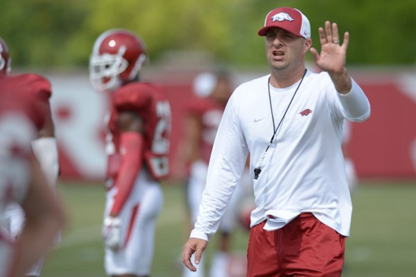 Arkansas assistant coach Barry Lunney Jr. directs his players Thursday, Aug. 9, 2018, during practice at the university's practice facility in Fayetteville. Visit nwadg.com/photos to see more photos from practice.