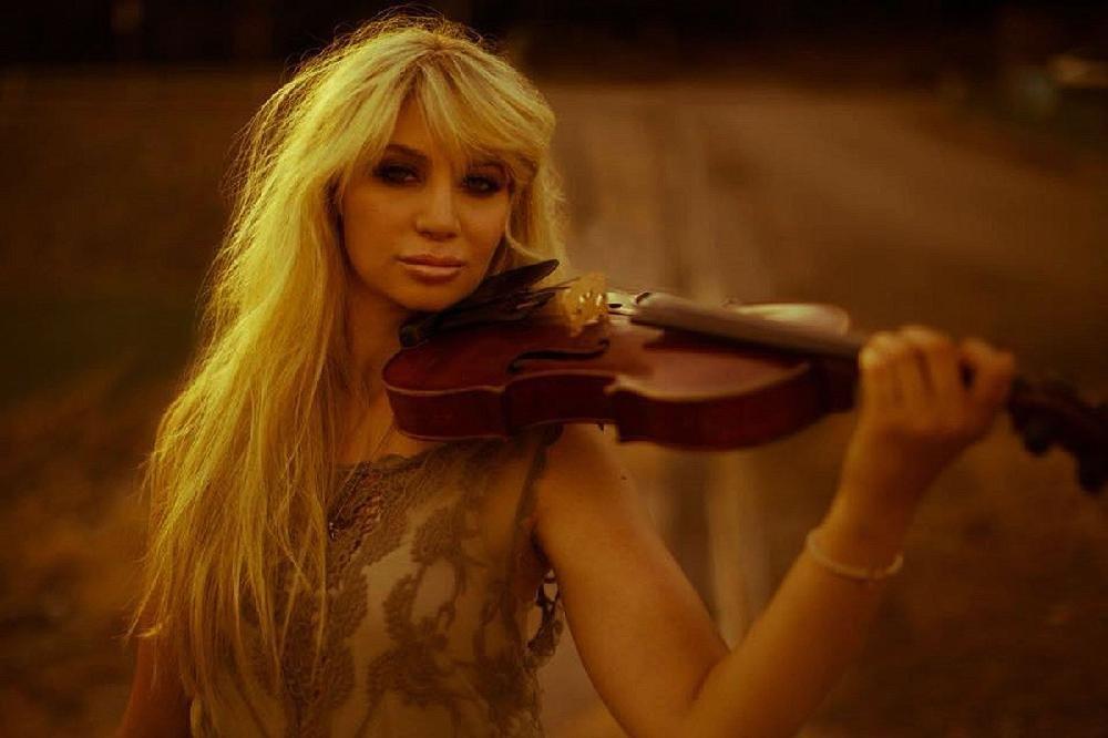 Lacie Carpenter performs at the Boomtown Opry Saturday at the El Dorado Municipal Auditorium.