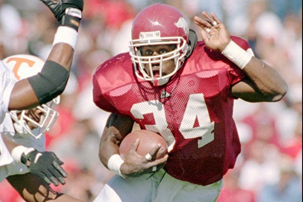 Arkansas running back Madre Hill evades a Tennessee defender during a game Saturday, Oct. 23, 1995, in Fayetteville. (AP Photo/Danny Johnston)