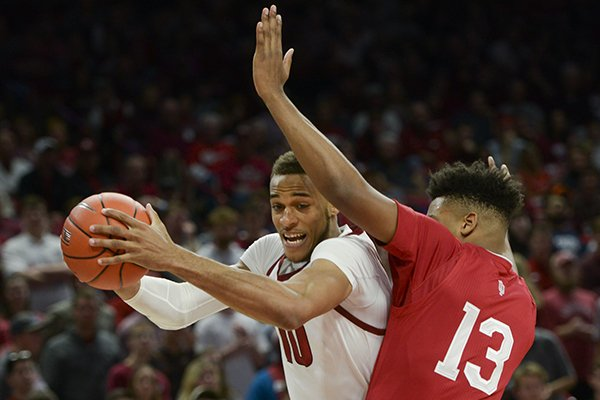 Arkansas forward Daniel Gafford (10) contacts Indiana forward Juwan Morgan (13) during a basketball game Sunday, Nov. 18, 2018, at Bud Walton Arena in Fayetteville.