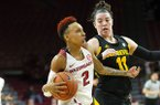 Arkansas guard Alexis Tolefree drives to the basket as Arizona State's Robbi Ryan defends at Bud Walton Arena on Sunday, Nov. 18, 2018, in Fayetteville.